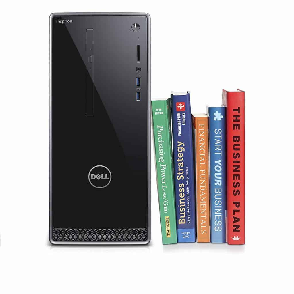 Image of the Dell Inspiron i3650-5609SLV Desktop next to books