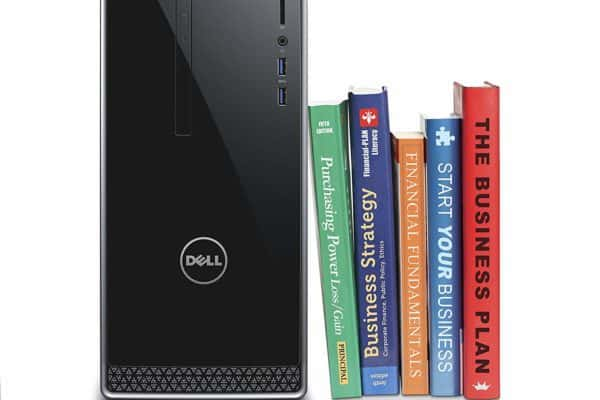 Image of the Dell Inspiron i3650-5609SLV Desktop next to books