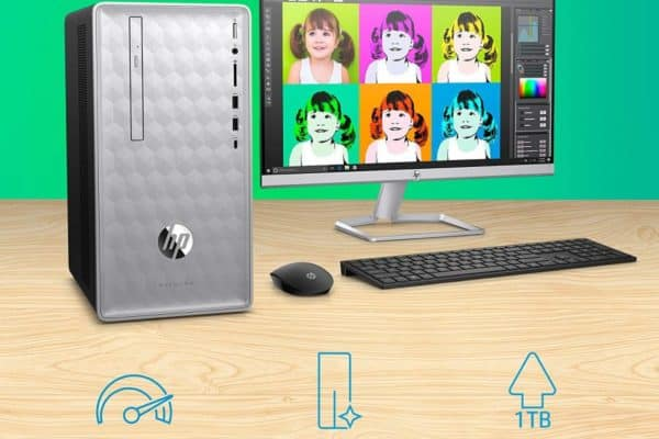 Image shows the HP Pavilion 590-p0070 Desktop and a monitor on a surface