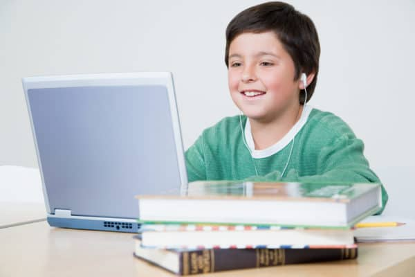 Elementary student using a laptop