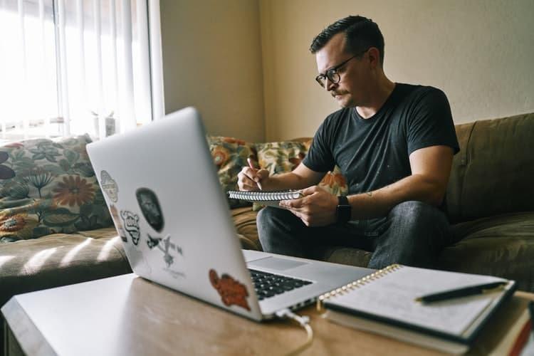 Man using his laptop for remote work at home