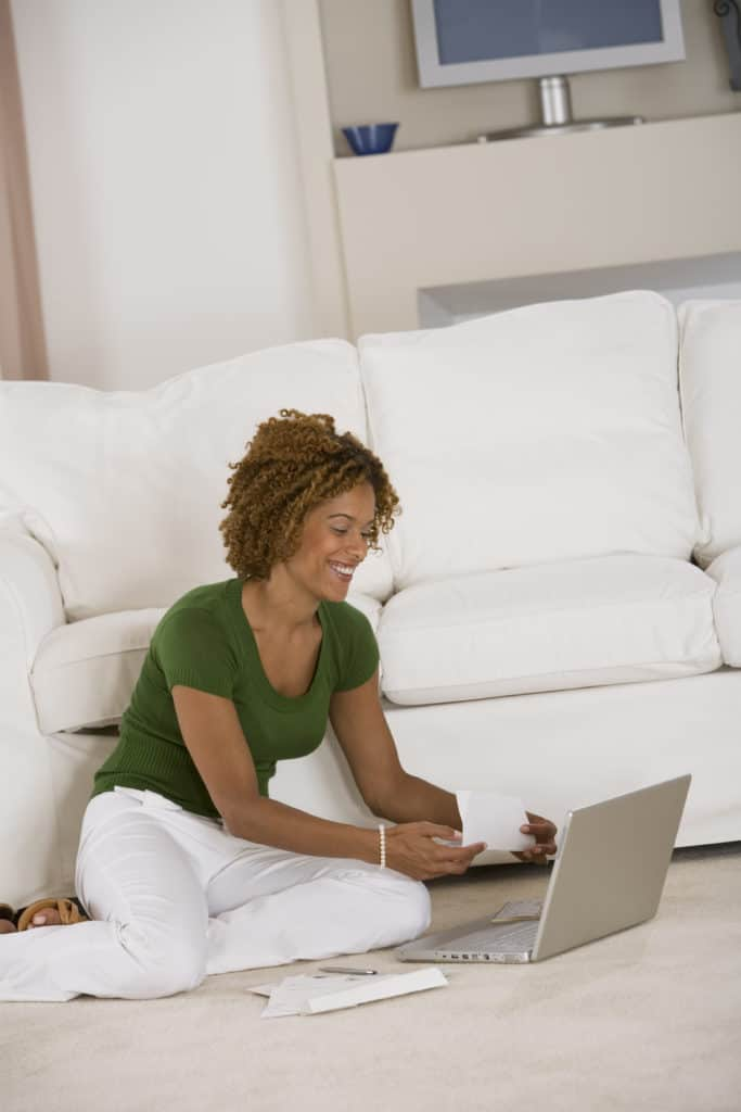 Woman using her laptop for remote work at home
