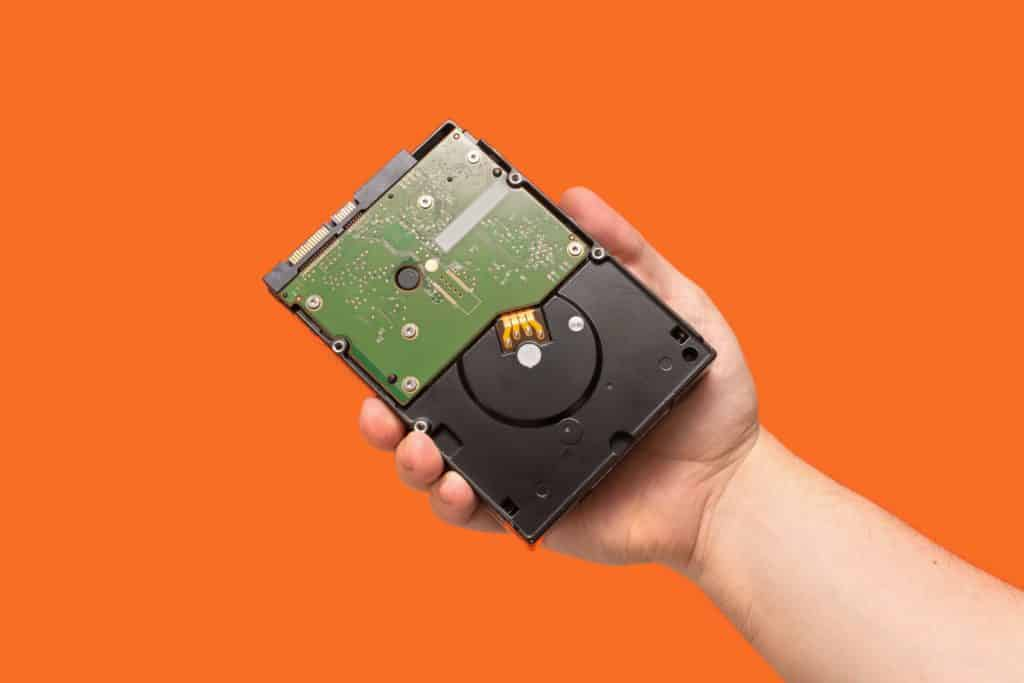 Person holding a hard disk drive storage for gaming