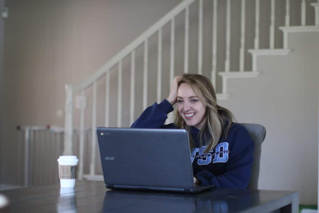 College student using her laptop at home