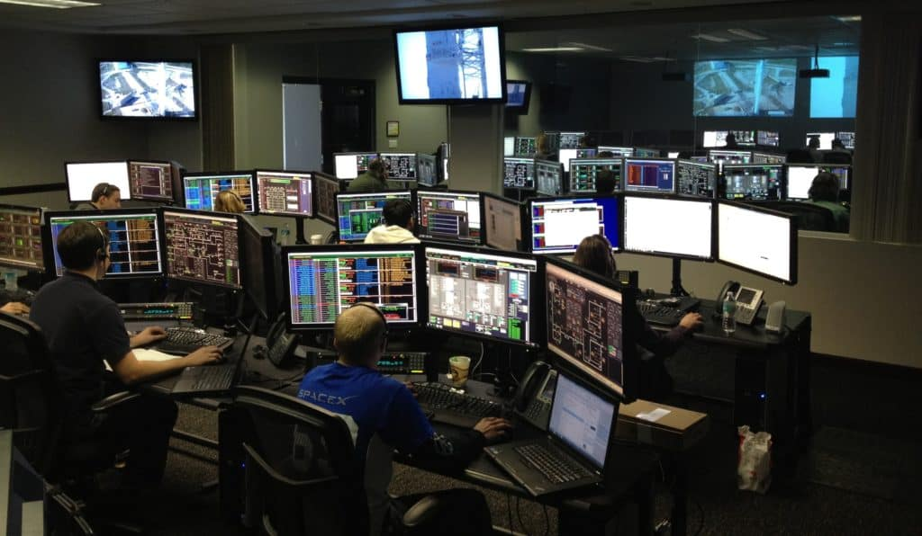 An office that uses a three monitor system for all its employees