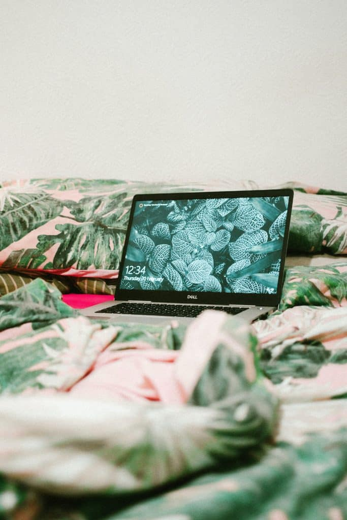 Dell laptop placed on a bed