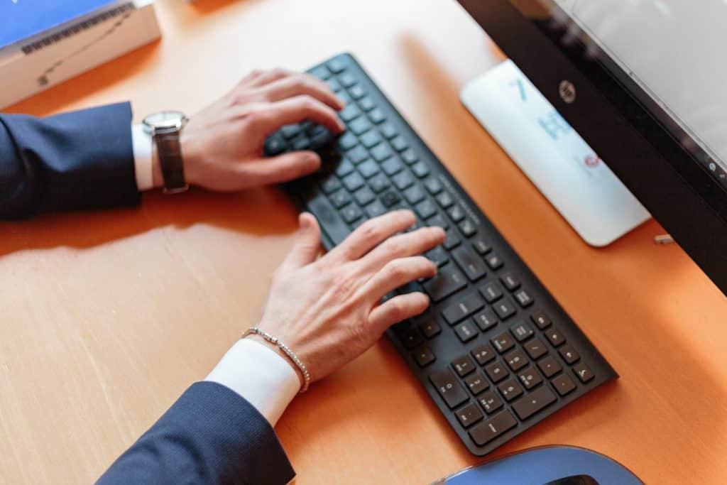 Wireless keyboard being used on a Mac