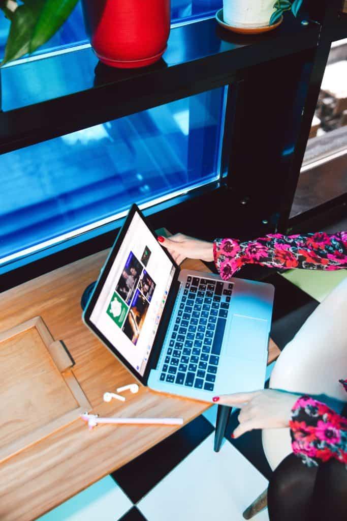 Woman browsing through her laptop