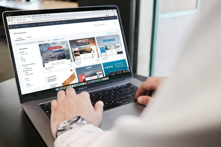Person internet surfing using their laptop
