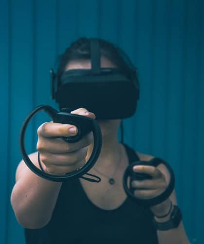 Woman wearing VR gear, while playing a game