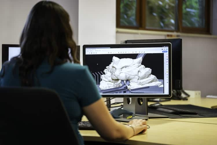 Woman looking at her computer monitor after creating a 3d image