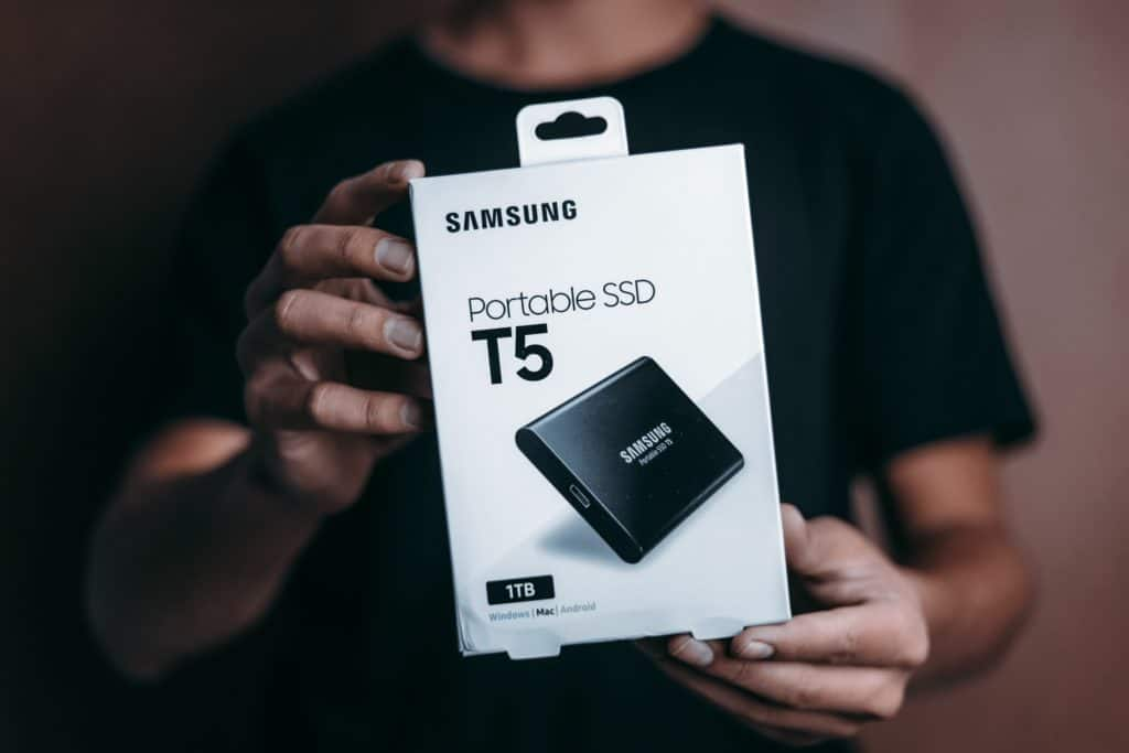 Man holding a box of Samsung portable SSD T5