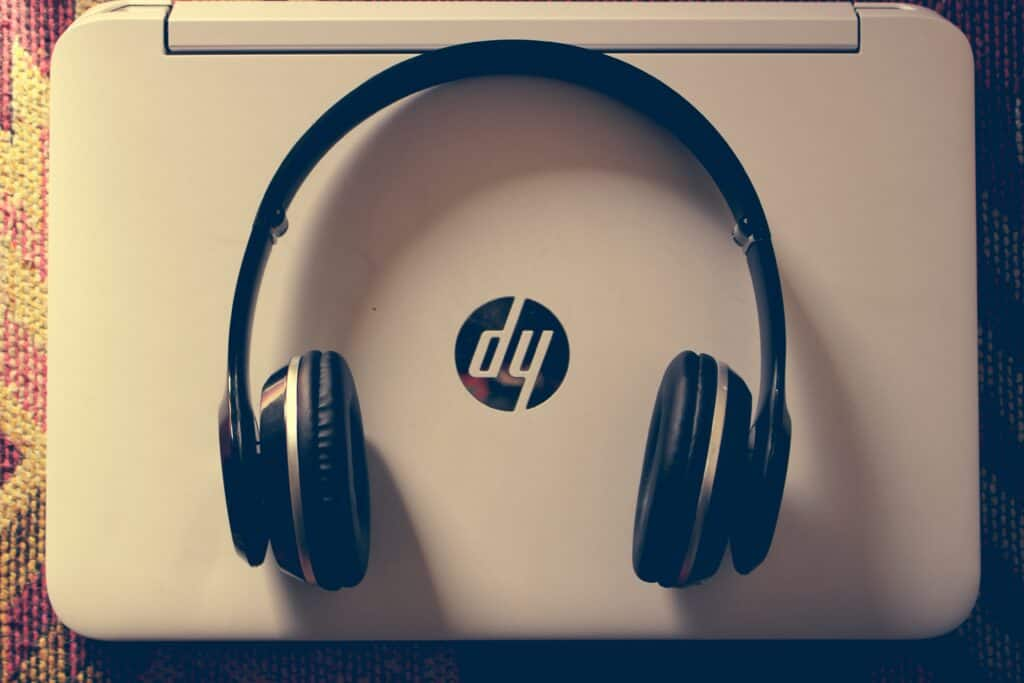 Headphone placed on top of an HP laptop