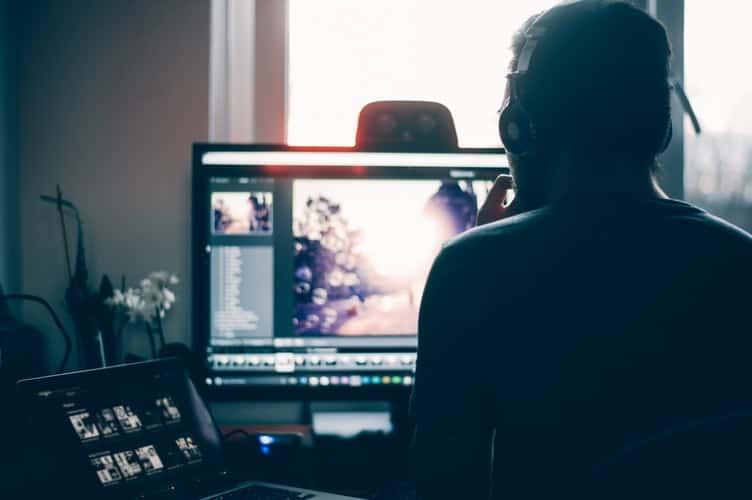 Man looking at his computer monitor
